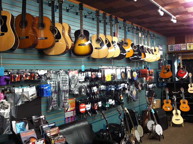 Acoustic guitars, electric guitars, banjos, guitar straps, guitar strings, and guitar cases at The Symphony Music Shop in North Dartmouth, MA