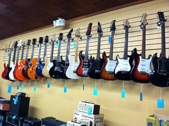 Electric guitars, acoustic guitars, banjos, guitar straps, guitar strings, and guitar cases at The Symphony Music Shop in North Dartmouth, MA